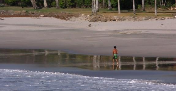 dahmian walking Flamingo Beach