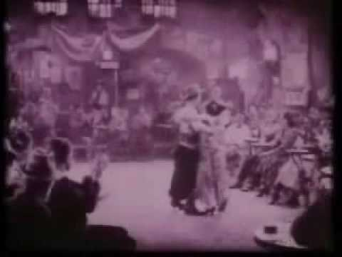 Rudolph Valentino, TANGO DANCING Famous Tango dance scene from the film THE FOUR HORSEMEN OF THE APOCALYPSE (1921) into which the music of the tango LA CUMPARSITA was added as an experiment. The girl dancer is Beatrice Dominguez. LA CUMPARSITA tango was a favorite of Rudolph Valentino. He was a talented dancer. Valentino is a Hollywood legend.